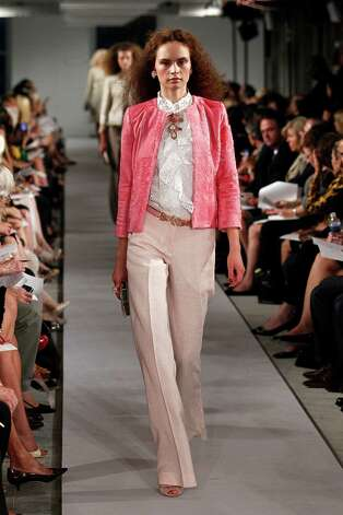 What to wear: Neutral-hued trousers are worn with a white eyelet top and pulled together with a pink three-quarter sleeve jacket (all from Oscar de la Renta), a great summertime option that will keep you cool outside and keep the chill off at work. Photo: Peter Michael Dills, Stringer / 2011 Getty Images