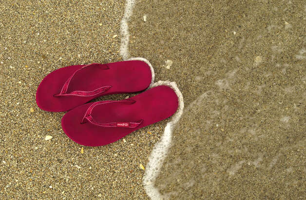 Flip-flops are always a no-no in the workplace and best for wearing to the beach. Photo: MICHAEL LAUGHLIN, MBR / SOUTH FLORIDA SUN-SENTINEL