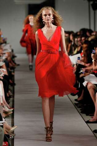 What not to wear: The color, shape, fabric and styling of this Oscar de la Renta dress may look office apprpriate but leave the cleavage for another time and place, not for the office. Photo: Peter Michael Dills, Stringer / 2011 Getty Images