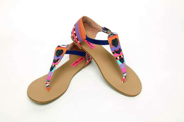 These Betsey Johnson neon Southwestern print thong sandals with bead adornment and a short heel are work appropriate. According to style mavens, sandals have become acceptable in the workplace during hot weather months. The experts suggest your sandals have a closed back and a heel and are adorned with stones and beads. Flip flops or thong sandals are unacceptable and not professional-looking for work. Photo: JUANITO M GARZA / San Antonio Express-News
