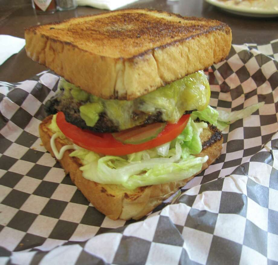 The New Mexican burger at Old Towne Grille & Spirits comes with not-so-hot Hatch chiles and Monterey Jack.  Photo: Jessica Elizarraras, San Antonio Express-News