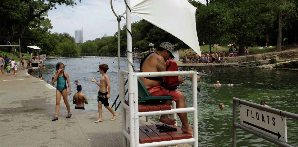 Barton Springs Pool, the famed Austin treasure that draws 400,000 visitors a year, remains open for