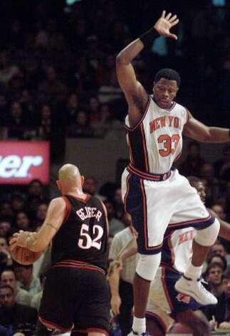 New York Knicks' Patrick Ewing, right, attempts to block a shot by  Philadelphia 76ers' Matt Geiger in the first half Friday, Dec. 10, 1999 in New York. (AP Photo/Mark Lennihan)