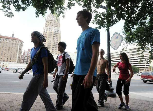 Members of Parkour San Antonio walk in downtown San Antonio on Friday, June 8, 2012. Photo: Billy Calzada, San Antonio Express-News / © 2012 San Antonio Express-News