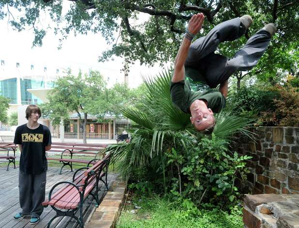Mike Avery of Parkour San Antonio twists in the air at Hemisfair Park on Friday, June 8, 2012. Photo: Billy Calzada, San Antonio Express-News / © 2012 San Antonio Express-News