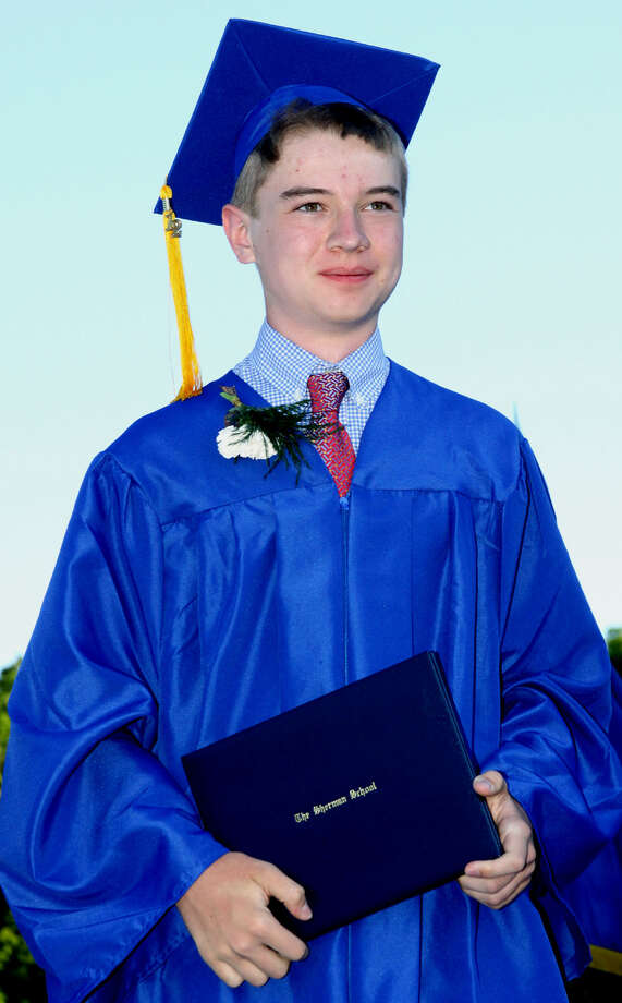 Austin Davis stands tall with his diploma at the Sherman School graduation exercises, June 15, 2012 Photo: Walter Kidd
