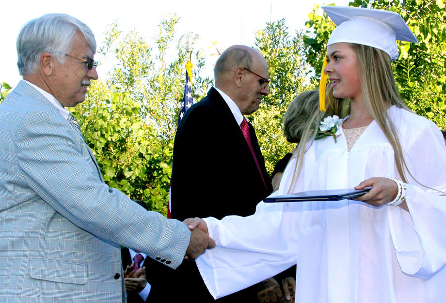 Superintendent Donald Fiftal congratulates graduate Sarah Ristevski at the Sherman School graduation exercises, June 15, 2012 Photo: Walter Kidd