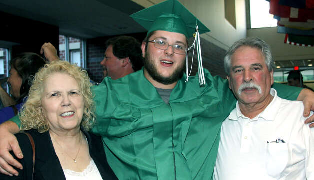 Grandparents Stella and Pete Koval proudly pose with new graduate Kyle Pickle following the New Milford adult education graduation exercises. June 13, 2012 Photo: Walter Kidd