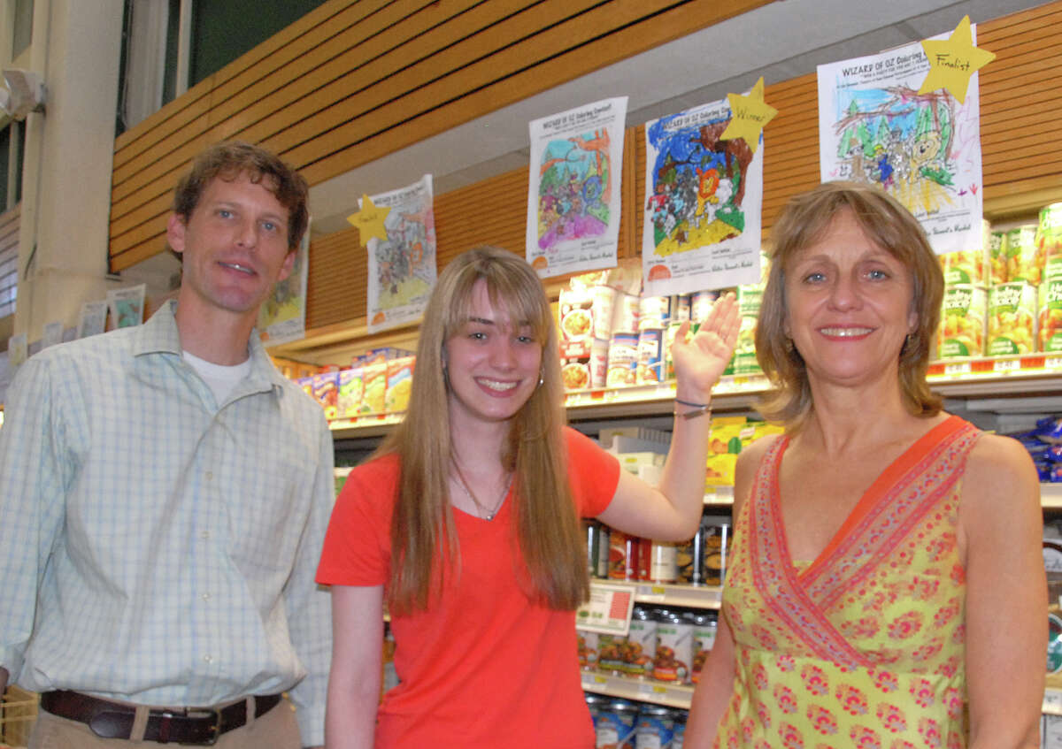 Alex Stewart, general manager of Walter StewartâÄôs, Lilla Goettler (Summer Theatre of New Canaan College Intern) and Melody Libonati, artistic director Summer Theatre of New Canaan choose a winner from more than 50 coloring entries.