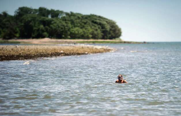 A boy snorkles in the Long Island Sound Wednesday, June 27, 2012 at Silver Sands State Park in Milford, Conn.  The beach is closed due to poor water quality.  Rocky Neck State Park in Niantic is also closed and the east end of Sherwood Island State Park in Westport is closed. Photo: Autumn Driscoll / Connecticut Post