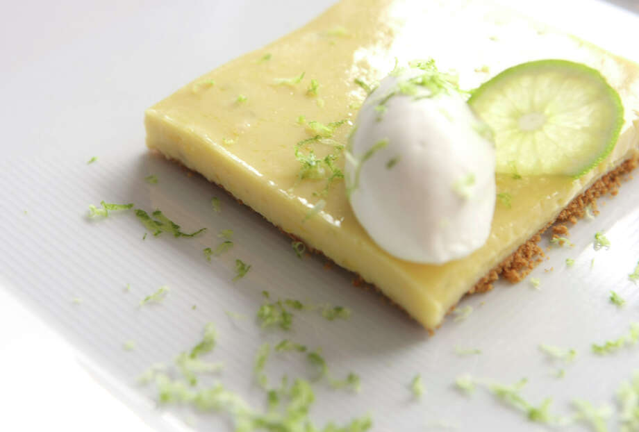 Originating in Key West, key lime pie is popular for Miami's dessert-lovers. The pie is the official state pie of Florida. The filling for the pie is made with key lime juice, egg yolk and sweetened condensed milk. Photo: HELEN L. MONTOYA, SAN ANTONIO EXPRESS-NEWS / hmontoya@express-news.net