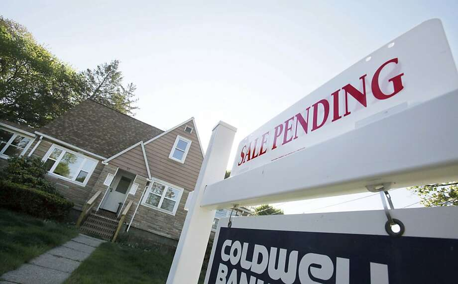 FILE-In this April 26, 2012, file photo, a sign advertises a pending residential real estate sale in Framingham, Mass. Home prices rose in nearly all major U.S. cities in April from March, further evidence that the housing market is slowly improving even while the job market slumps. (AP Photo/Bill Sikes) Photo: Bill Sikes, Associated Press
