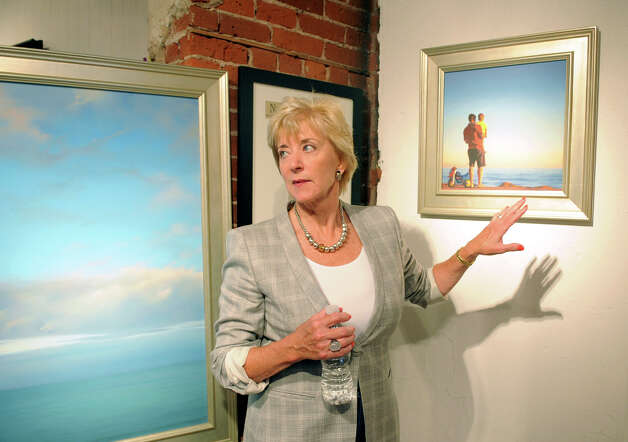 Republican Party-endorsed U.S. Senate candidate Linda McMahon looks at artwork at Galerie SoNo as she is taken on a walking tour of South Norwalk by Mayor Dick Moccia on Wednesday, June 27, 2012. Photo: Lindsay Niegelberg / Stamford Advocate