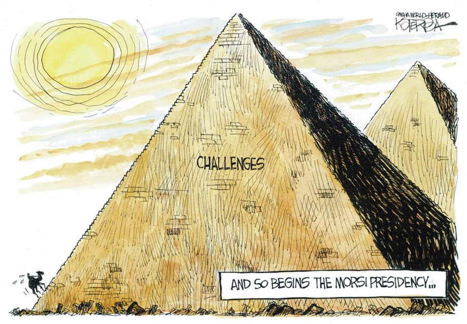 """Today's editorial cartoon, """"Morsi Egypt,"""" is by Jeff Koterba of the Omaha World Herald Photo: Jeff Koterba"""