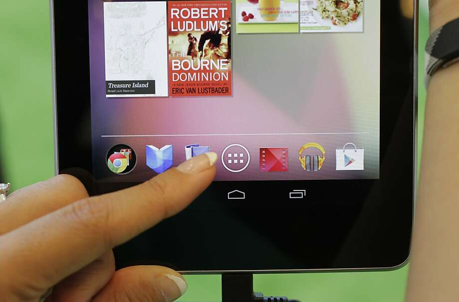 The Nexus 7, above, iPad or Kindle Fire tablets are good choices for college students. Photo: Paul Sakuma, Associated Press