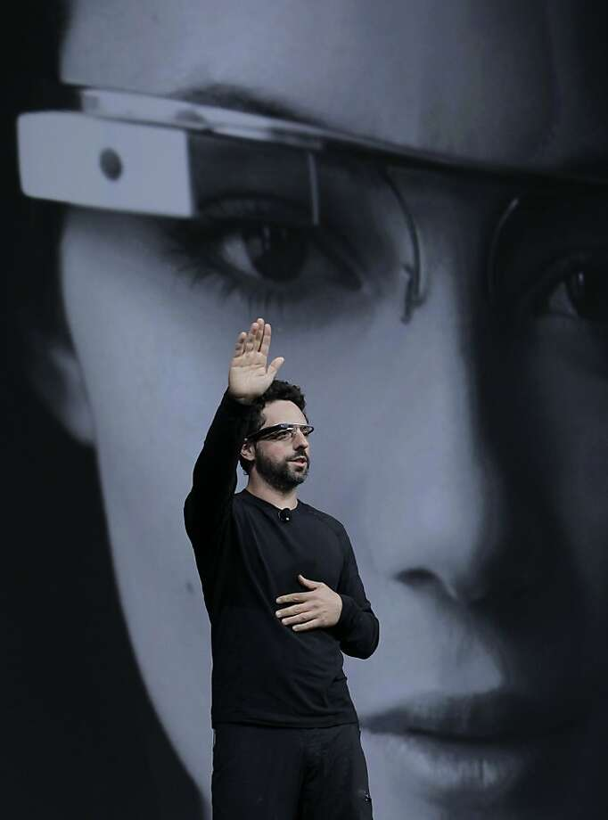 Google co-founder Sergey Brin demonstrates Google's new Glass, wearable internet glasses, at the Google I/O conference in San Francisco, Wednesday, June 27, 2012.  The audience got live video feeds from their glasses as they descended to land on the roof of the Moscone Center, the location of the conference. (AP Photo/Paul Sakuma) Photo: Paul Sakuma, Associated Press
