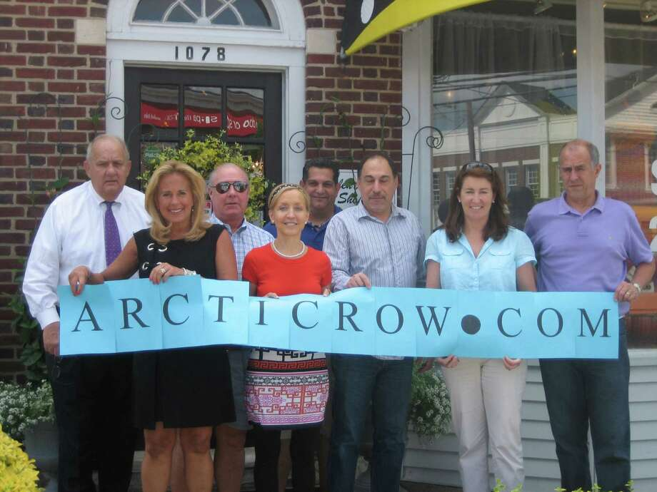Twelve Darien businesses contributed to the upcoming Arctic Row. Pictured areTom McKiernan of Abercrombie Burns McKiernan & Co; Erica Jensen of Helen Ainson; Tom Geary of Accent Picture Framing and Geary Gallery; Maud Purcell of The Life Solutions Center; Vinny DeRentiis of Darien Auto Specialists; Charles Michael of Charles Michael Gallery; Sandy Nielsen of Nielsen's Florist and Garden Shop; and Bill Jensen of the Darien Toy Box. Photo: Contributed Photo