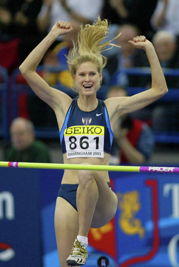 Amy Acuff of the United States celebrates after making a clean during jump in the Women's high jump qualifying at the World Indoor Athletics Championships in Birmingham, England, Saturday March 15, 2003. (AP Photo/Alastair Grant) Photo: AP, STR / 2003 AP