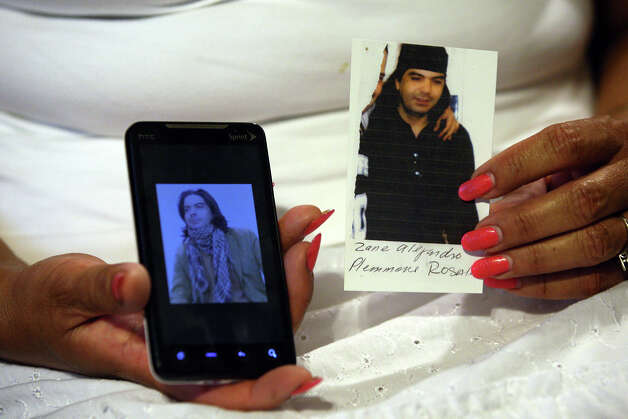Maria Plemmons displays photos of her missing son, Zane Alejandro Plemmons, who went missing May 21 in Nuevo Laredo while on a trip to visit family in Mazatlán. Photo: Jerry Lara, San Antonio Express-News / © 2012 San Antonio Express-News
