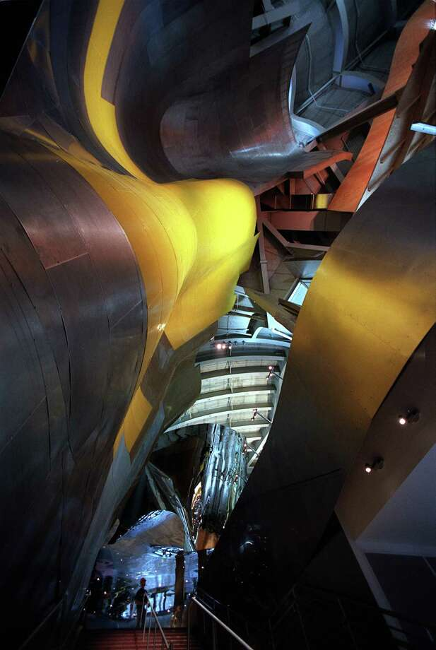 """'The Blob,' as it is fondly referred to, combines the most important aspects of the architectural movement of the same name – soft, flowing forms that come together to produce a complex whole,"" Emporis wrote. ""The metallic facade reflects a breathtaking play of colors from gold, to silver, to luminous violet.""Wait, 'fondly'? We're not so sure about that. Oh well, click on for more blobs. Photo: PAUL KITAGAKI JR., SEATTLE POST-INTELLIGENCER"