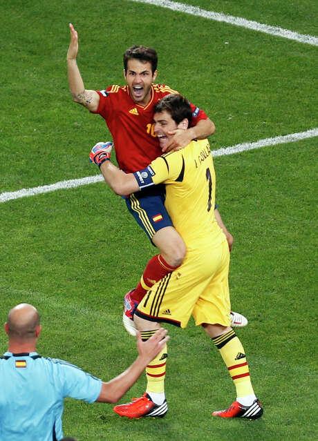 Spain's Cesc Fabregas (left) rejoices with  goalkeeper Iker Casillas after scoring the decisive goal in the shootout. Photo: AP