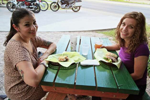 Michelle Garcia and Blanca Rosa Braswell are regulars at The Filling Station Tap Room. Photo: Xelina Flores-Chasnoff