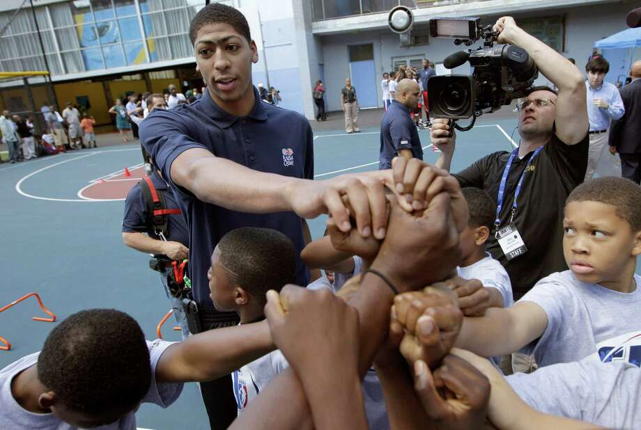 Anthony Davis, the unquestioned No. 1 overall prospect of tonight's draft, takes time out with youngsters at an NBA fitness clinic in New York. Photo: AP