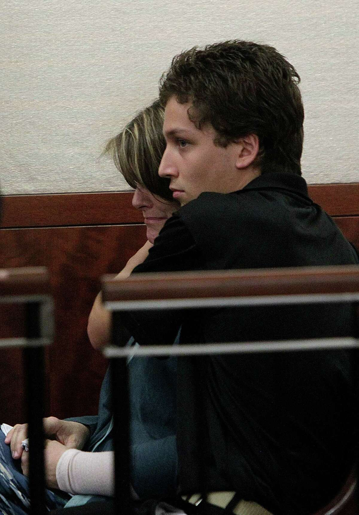 Donna Rodriguez is embraced by Daniel Rodriguez as her husband Raul Rodriguez is sentenced 40 years in prison in the 178th State DIstrict Court at the Harris County Criminal Justice Center on Wednesday, June 27, 2012, in Houston. Rodriguez is sentenced 40 years in prison for the shooting death of Kelly Danaher.