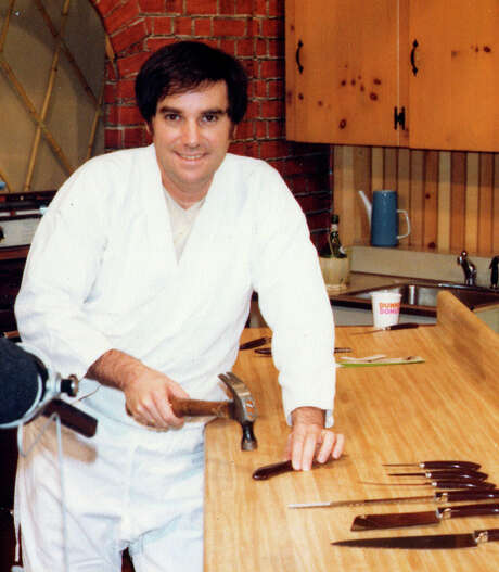 "In this 1978 photo made available by PriMedia shows Barry Becher at a studio using a hammer on a Ginsu knife. Becher, a marketing mastermind and infomercial pioneer best know for bringing Ginsu knives to the American public, died of complications from surgery. He was 71. Becher was buried in Tamarac, Fla., on Monday, June 25, 2012. His family is considering etching in his tombstone one of the carchphrases he help popularize: ""But wait, there's more."" Photo: AP"