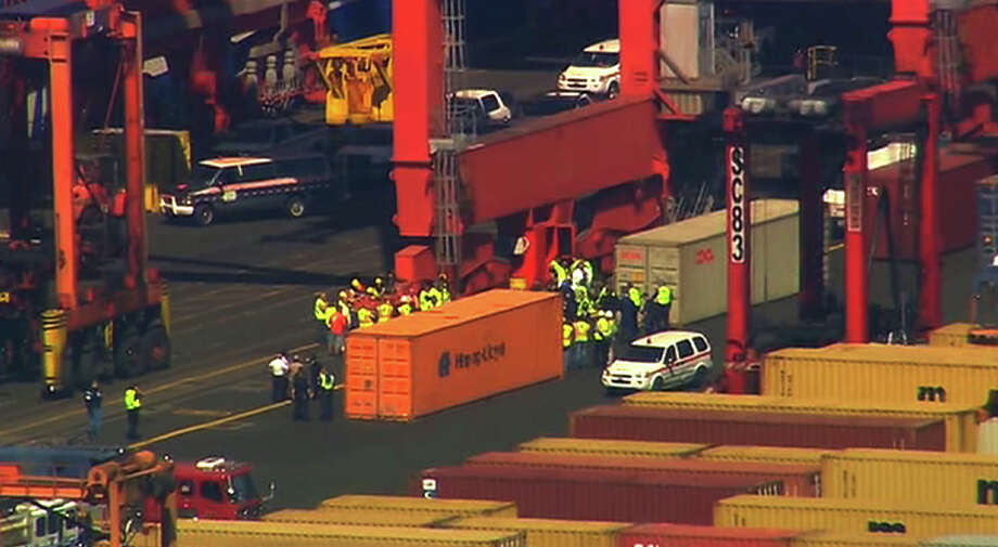 This image made from video provided by Eyewitness News WABC-TV shows an aerial view near a container ship in Newark with suspected stowaways. Dock workers rushed to unload containers stacked on top of one another inside a cargo ship that arrived in New Jersey from the Middle East on Wednesday, June 27, 2012 after Coast Guard officials heard knocking from one during a routine inspection, suggesting that stowaways might be on board. (AP Photo/Eyewitness News WABC-TV) MANDATORY CREDIT Photo: AP