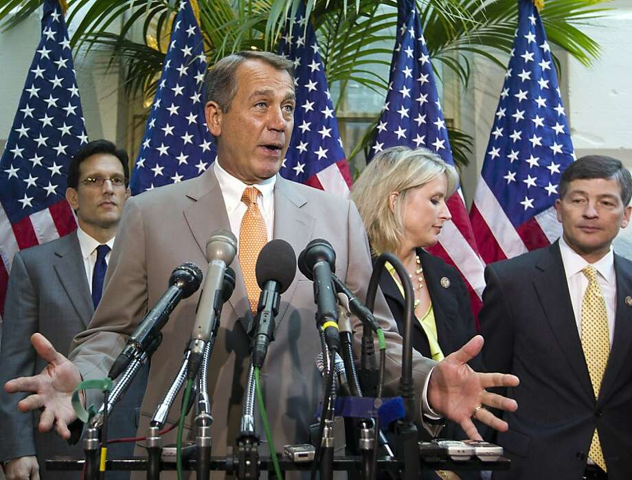 House Speaker John Boehner, R-Ohio, joined by other House GOP leaders, faces reporters at a news conference following a political strategy session, on Capitol Hill in Washington, Wednesday, June 27, 2012. Boehner defended the contempt of Congress vote against Attorney General Eric Holder, commented on the looming Supreme Court decision on the health care, and updated progress on student loans and the transportation bill. From left to right are House Majority Leader Eric Cantor, R-Va., Boehner, Rep. Renee Ellmers, R-NC, and Rep. Jeb Hensarling, R-Texas. (AP Photo/J. Scott Applewhite) Photo: J. Scott Applewhite, Associated Press