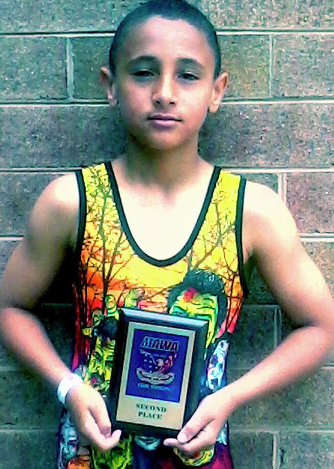Javon Priar of New Milford complemented his efforts as a fourth-grade student at Sarah Noble Intermediate School in New Milford by competing for the Danbury youth wrestling program. 2012 Courtesy of Tiffany Cole Photo: Contributed Photo