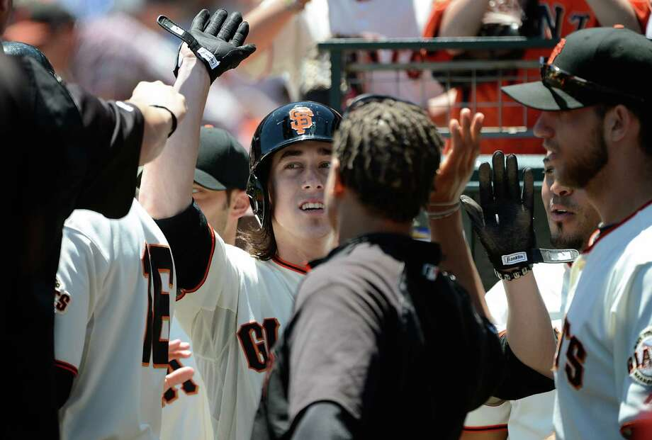 Giants pitcher Tim Lincecum is congratulated after scoring on a double by Melky Cabrera. Photo: Thearon W. Henderson, Getty Images / 2012 Getty Images