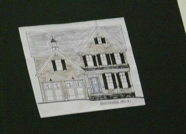 A drawing of one of the three homes proposed for property at 50 Chatham Road. Photo: Genevieve Reilly / Fairfield Citizen