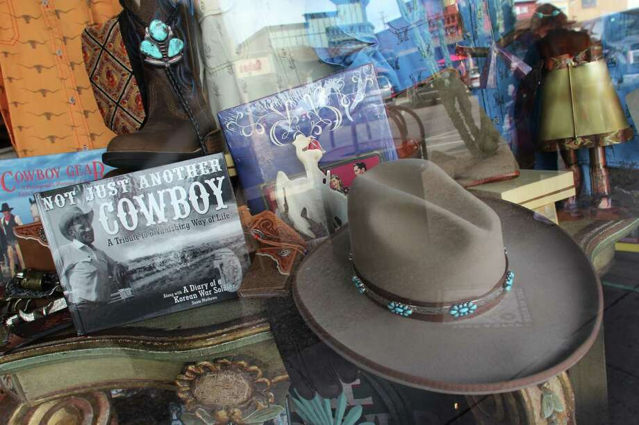 "Western paraphernalia fills the window at Bischoff's Shades of the West store in Old Town Scottsdale. In the 1940s, the city adopted the slogan, ""The West's Most Western City."" Photo: Spud Hilton / The Chronicle"
