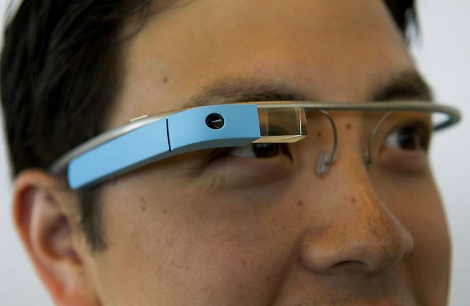 Google Inc employee Ray Liu, wears Project Glass internet glasses during a demonstration during at the Google I/O conference in San Francisco, California, U.S., on Wednesday, June 27, 2012. Google Inc. unveiled a $199 handheld computer called the Nexus 7 that features a 7-inch screen and is designed to help the company vie with Apple Inc., Microsoft Corp. and Amazon.com Inc. in the surging market for tablets. Photographer: David Paul Morris/Bloomberg *** Local Caption *** Ray Liu Photo: David Paul Morris, Bloomberg