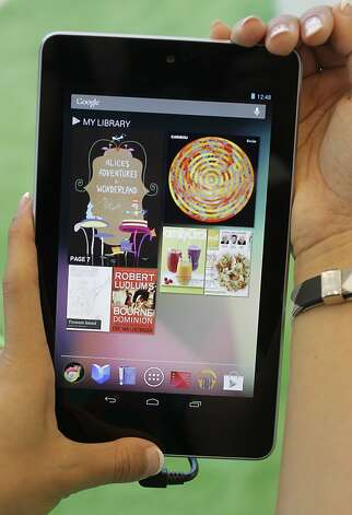 Google's Cheryl Pon shows off  the new Google Nexus 7 tablet at the Google I/O conference in San Francisco, Wednesday, June 27, 2012. The Nexus 7 will ship in mid-July starting at $199 ? the same price as the Kindle Fire. By contrast, iPads start at $499. (AP Photo/Paul Sakuma) Photo: Paul Sakuma, Associated Press
