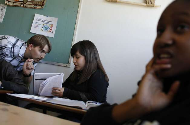 Erik Yergensen (left) helps Jocelyne Umanzor, 14, during an Algebra 2 summer class. Photo: Lea Suzuki, The Chronicle