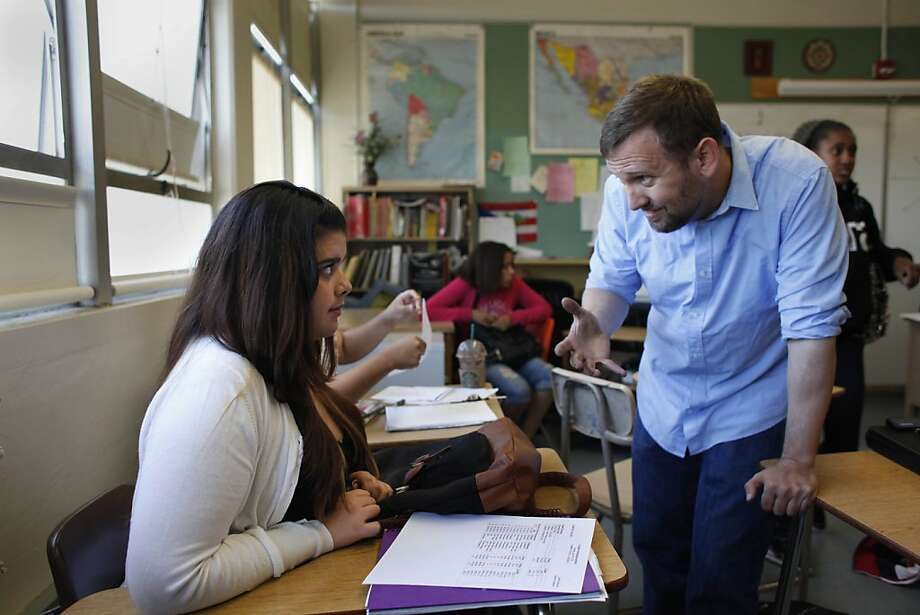 Math teacher David Zeeman (right), talks with Celeste Chacon, 15, during an algebra summer school class at Lowell High School on Wednesday. Photo: Lea Suzuki, The Chronicle