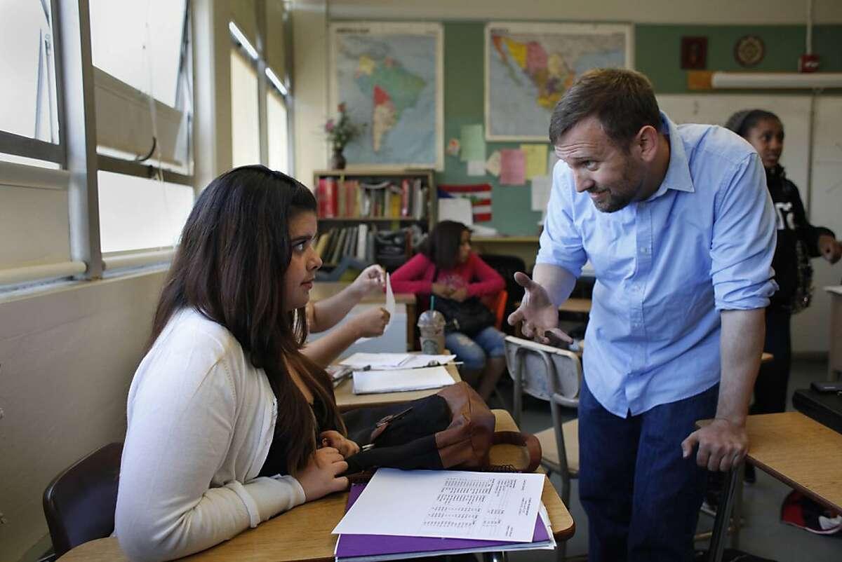Math teacher David Zeeman (right), talks with Celeste Chacon, 15, during an algebra summer school class at Lowell High School on Wednesday.