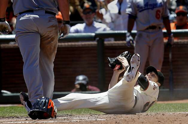 Tim Lincecum convinces home plate umpire Fieldin Culbreth that he tagged out Chad Billingsley. Photo: Brant Ward, The Chronicle