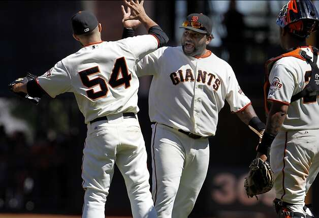 Pablo Sandoval congratulated Sergio Romo (54) after his save. The San Francisco Giants beat the Los Angeles Dodgers 3-0 Wednesday June 27, 2012 at AT&T park. Photo: Brant Ward, The Chronicle