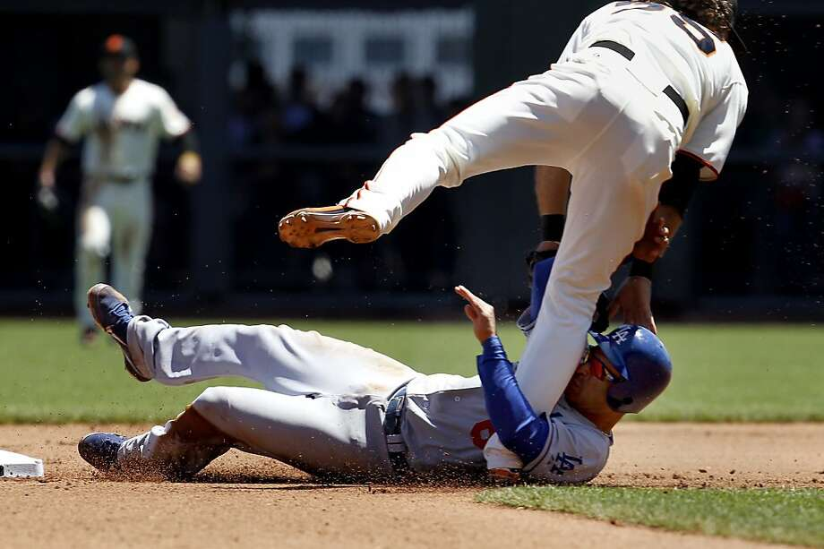 The Dodgers Jerry Hairston and the Giants Brandon Crawford collided after a great catch by Hector Sanchez. The San Francisco Giants vs. the Los Angeles Dodgers in the last of a three game series Wednesday June 27, 2012 at AT&T park. Photo: Brant Ward, The Chronicle