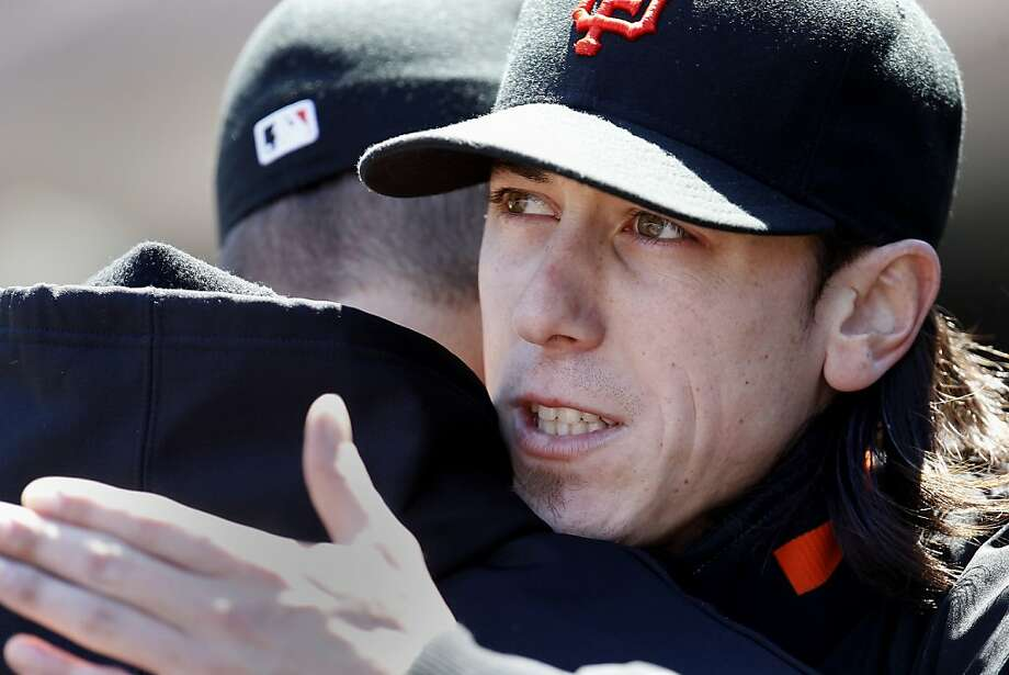 Tim Lincecum got a hug from a teammate after he left the game at the end of the 7th inning. The San Francisco Giants vs. the Los Angeles Dodgers in the last of a three game series Wednesday June 27, 2012 at AT&T park. Photo: Brant Ward, The Chronicle