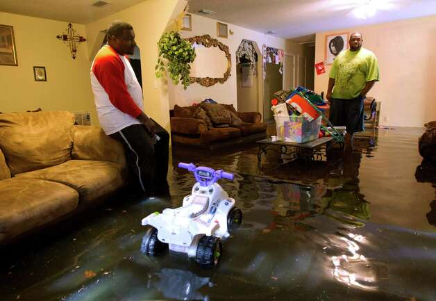 TROPICAL STORM DEBBY: This storm, which hit Florida in late June, caused a lot of heartache with massive flooding, and killed at least seven people in the U.S., Cuba and Central America. Above, Gordon McClain, left, surveys his water-filled living room in Live Oak Fla., June 27, 2012. Dozens of homes and much of the downtown area was flooded by torrential rains from Debby. Photo: Dave Martin, Associated Press / AP