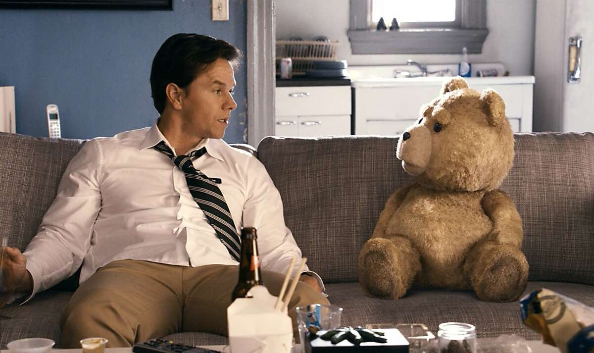 John (MARK WAHLBERG) hangs out with his best friend, Ted (voiced by SETH MACFARLANE), in the live action/CG-animated comedy
