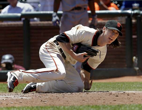 Tim Lincecum comes up after tagging out Chad Billingsley in the third inning. The San Francisco Giants vs. the Los Angeles Dodgers in the last of a three game series Wednesday June 27, 2012 at AT&T park. Photo: Brant Ward, The Chronicle