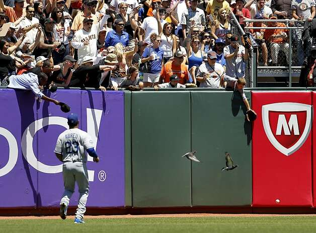 A double by Ryan Theriot scattered some pigeons in the outfield. The San Francisco Giants vs. the Los Angeles Dodgers in the last of a three game series Wednesday June 27, 2012 at AT&T park. Photo: Brant Ward, The Chronicle