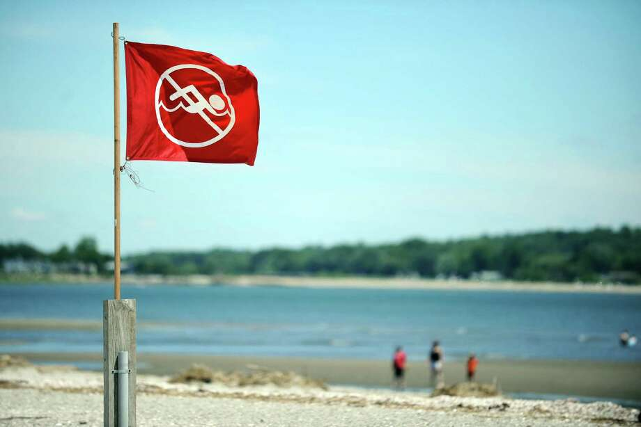The beach is closed due to poor water quality Wednesday, June 27, 2012 at Silver Sands State Park in Milford, Conn.  Rocky Neck State Park in Niantic is also closed and the east end of Sherwood Island State Park in Westport is closed. Photo: Autumn Driscoll / Connecticut Post