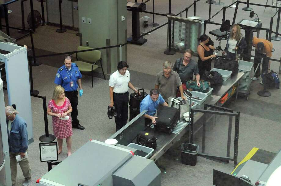 Airline passengers make their way through the security checkpoint at the Albany International Airport on Wednesday, June 27, 2012 in Colonie, NY.  Airport authority officials are advising passengers to arrive at least 90 minutes before flights, instead of 60 minutes previously.   (Paul Buckowski / Times Union) Photo: Paul Buckowski